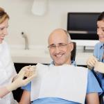 как можно быстрее привыкнуть к съемным зубным протезам
