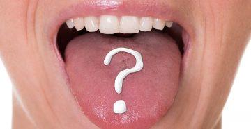 бело-зеленый налет на языке, причины его появления