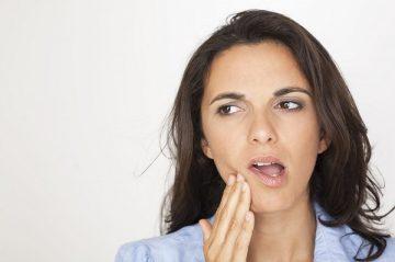 болит челюсть справа при жевании